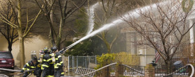 Firemen at work putting out a house fire